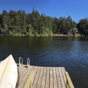 Pender Weekender b&b swim deck on Magic Lake with canoe