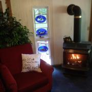 Pender Weekender bed and breakfast living room with fire place - Accommodation on Pender Island